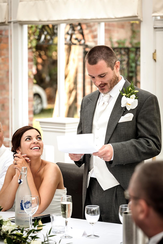 bride enjoys grooms speech   Nottingham Wedding Photographer