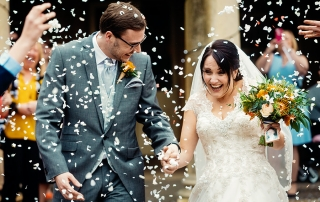 bride and groom in the middle of Confetti storm at Prestwold Hall