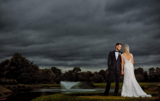 Bride and groom standing by the fountain at the Nottinghamshire Golf and Country Club