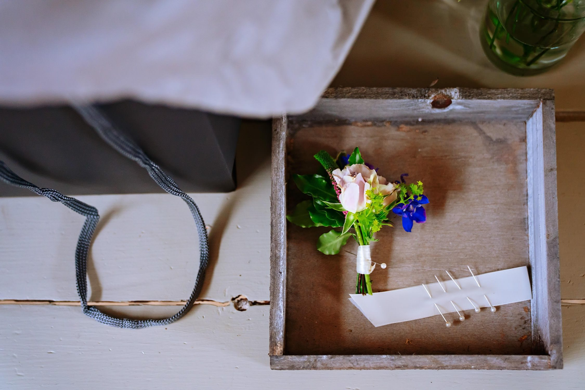 button hole in a box Wedding Details