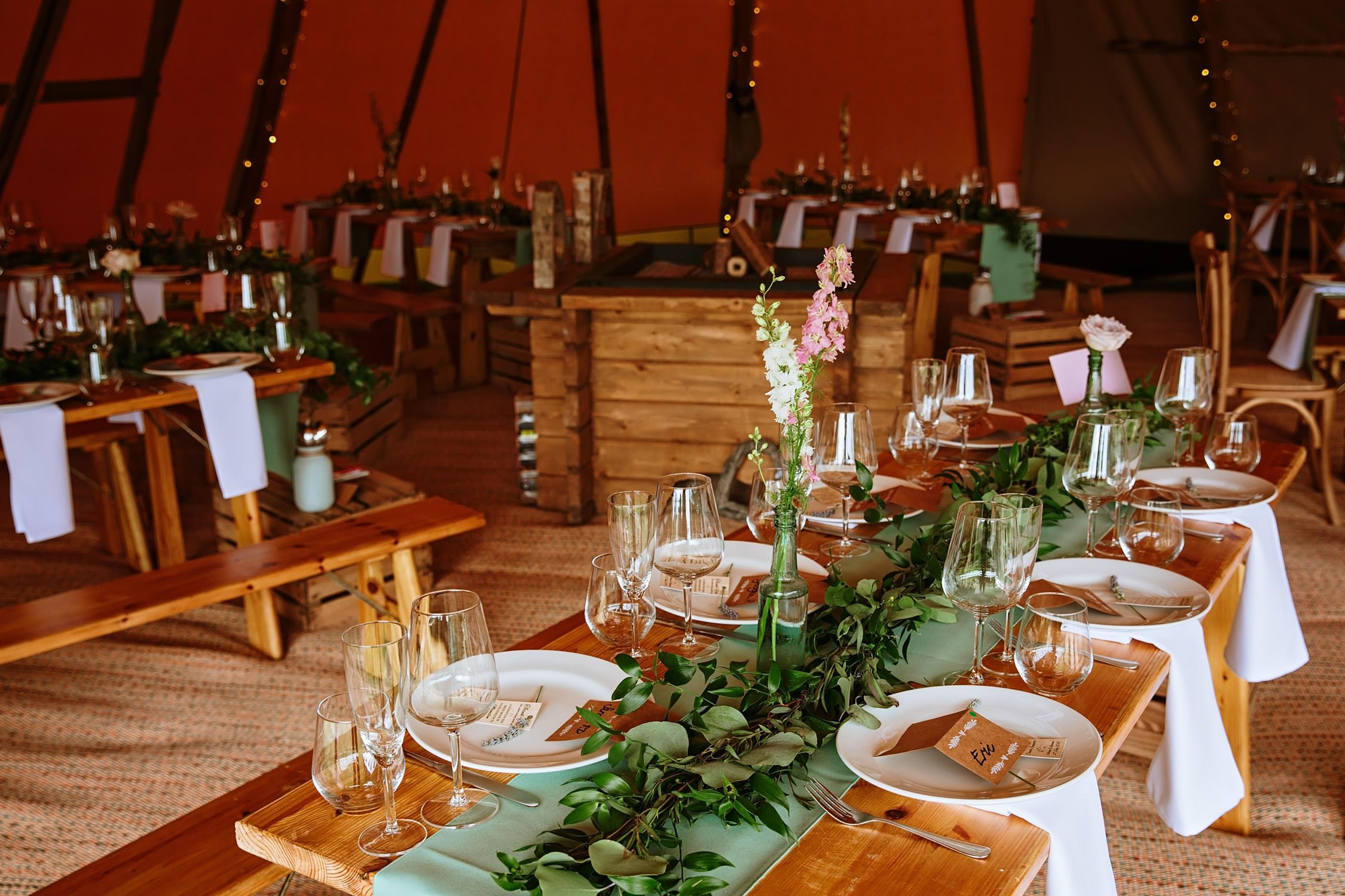 table settings in a teepee wedding details