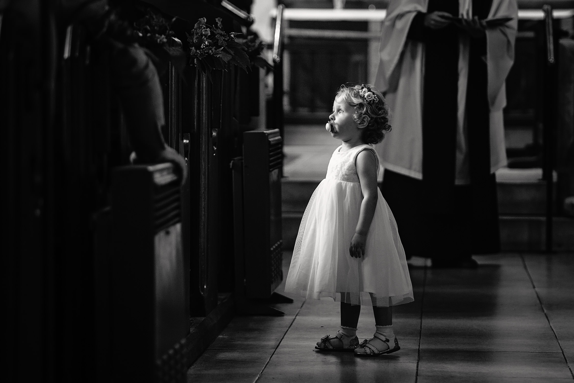 flower girl in the church aisle