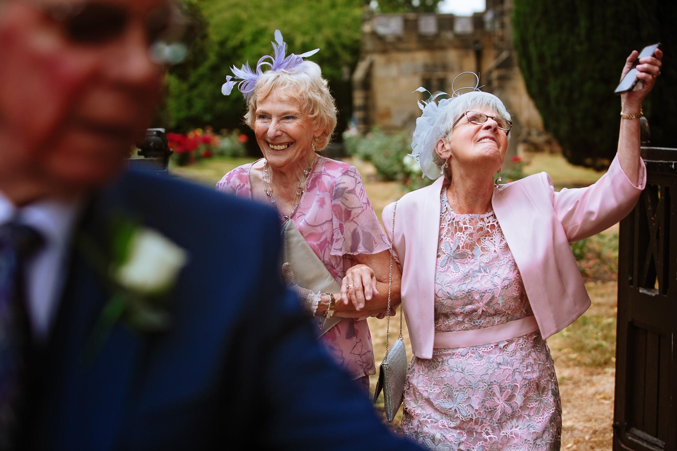 happy ladies at a church wedding